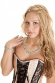 Necklace and pink corset — Stock Photo