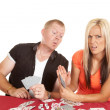 Man and woman playing cards he is peeking — Stockfoto #53132241