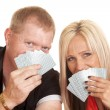 Man and woman smile behind playing cards — Stok fotoğraf #53132253