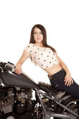 Woman sit backwards on motorcycle sit look back — Stock Photo