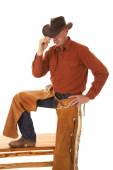 Cowboy chaps one leg up touch hat with hand — Stock Photo