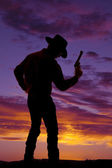 Cowboy with a gun in his hand — Stock Photo