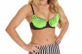 Close up woman lime green bra spike — Stock Photo