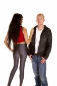 Man in black jacket front woman gray pants back — Stock Photo