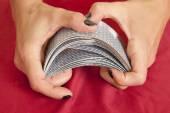 Hands shuffling cards — Stock Photo