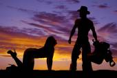 Silhouette of woman and cowboy — Stock Photo