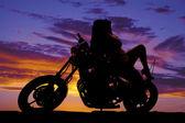 Silhouette woman sit backward on motorcycle — Stock Photo