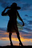 Silhouette of woman with hat — Stock Photo