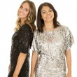 Women in shiny dresses smiling — Stock Photo #57937061