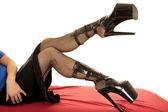 Womans legs in fishnet — Stock Photo