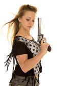 Woman camo pants star shirt gun close — Stock Photo