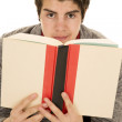 Man in sweater holding book look over it — Stock Photo #60847213