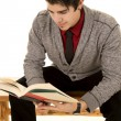 Man in sweater holding book read lean forward — Stock Photo #60847265