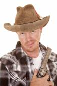 Cowboy close with gun smirk on face — Stockfoto