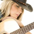 Cowgirl playing the guitar — Stock Photo #63084975