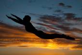 Silhouette woman flying in air — Stock Photo