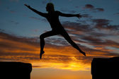 Silhouette woman jumping — Stock Photo
