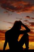 Silhouette woman stressed sitting — Stock Photo