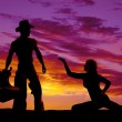 Silhouette of a cowgirl next to  cowboy — Stock Photo #64244625