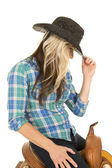 Cowgirl sitting on a saddle — Stock Photo