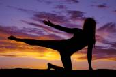 Silhouette of a woman doing a yoga — Photo