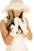 Woman in a white dress and hat — Stock Photo