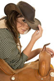 Young cowgirl with saddle — Stock Photo