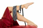 Woman legs with mans tie — Stock Photo