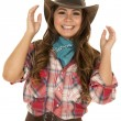 Cowgirl in red plaid shirt — Stock Photo #68496473