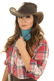 Cowgirl in red plaid shirt — Stock Photo