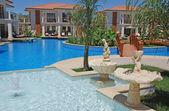 Swimming pool at the summer resort hotel — Stock Photo