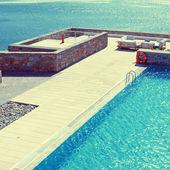 Pool and terrace over Mediterranean sea(Greece) — Stock Photo