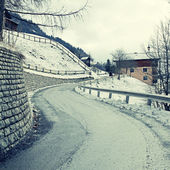 Curved country road in winter Alps — Zdjęcie stockowe