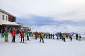Skiers enjoy skiing at the slope in the Austrian Alps — Stock Photo