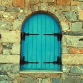 Vintage window with blue close shutters, Crete, Greece. — Stock Photo