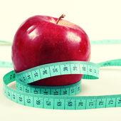 Measurement and apple — Stock Photo