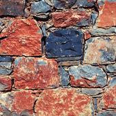 Muro de pedra áspero mediterrânico como plano de fundo — Fotografia Stock