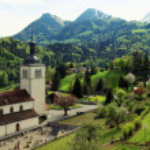 Church and Alps mountains, Gruyeres, Switzerland — Stock Photo #54841231