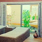 Wicker furniture in spa relax room. — Stockfoto