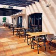 Open terrace cafe in mediterranean town — Stock Photo #56276059
