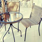 Iron table and chairs on balcony — Stock Photo