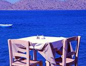 Traditional greek outdoor restaurant (Crete, Greece ). — Stock Photo