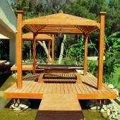 Wood pavilion for massage on summer resort — Stock Photo