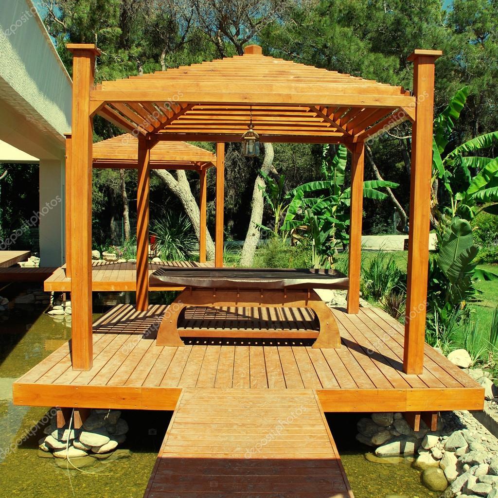 holz pavillon für die massage auf sommer-resort — stockfoto #57194623, Gartengerate ideen