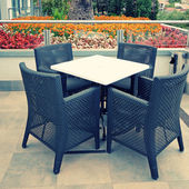 Hotel terrace with table and chairs — Stock Photo