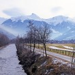 River, country road and Alps mountain in small village(Austria) — Stock Photo #59743657