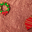 Handmade painting wood christmas decoration on gold crumpled tis — Stok fotoğraf #63524389