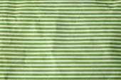 Crumpled paper with green stripes — Stock Photo