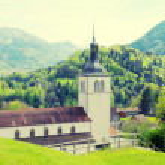 Church and Alps mountains, Gruyeres, Switzerland — Stock Photo #66554549