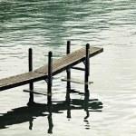 Old wood jetty at Lake Geneva, Switzerland — Stock Photo #67439403